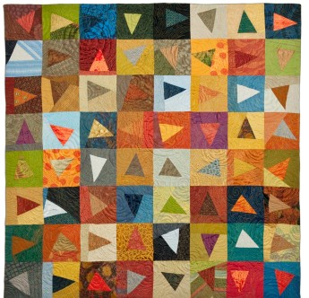 Flying Triangles (2012). Designed and Pieced by Tierney Davis Hogan. Quilted by Betty Anne Guadalupe. Photography by Jeremy Koons.