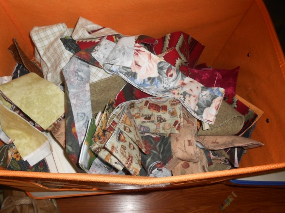 Box full of pre-cut 2 1/2 inch flannel strips ready for a log cabin quilt pattern!