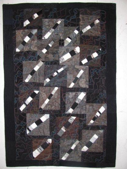 Designed, pieced and quilted by Betty Anne Guadalupe.