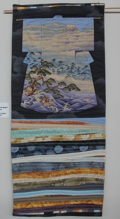 Niko's Secret Robe (2015). Pre-printed kimono panel with piecing by Tierney Davis Hogan. Quilted by T. Hogan.