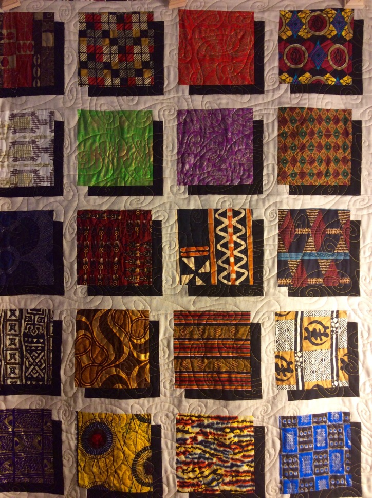 African Windows (2014). Pieced by Tierney Davis Hogan, quilted by Betty Anne Guadalupe.