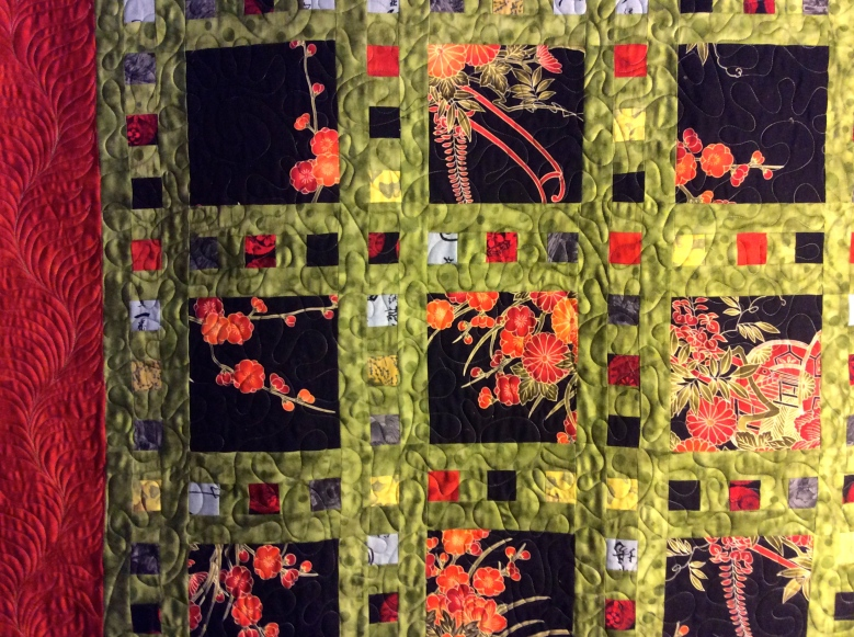 Asian Fabric Slideshow - pieced by T. Hogan, long arm quilting by BA Guadalupe