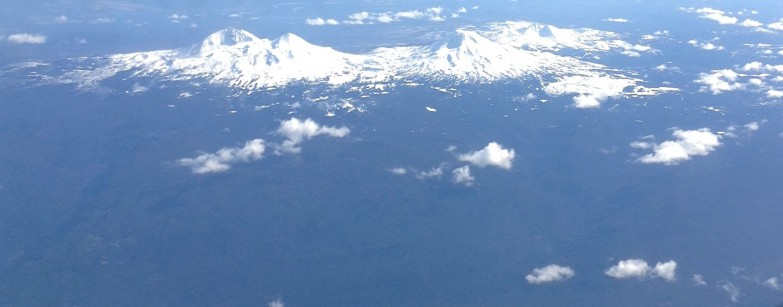 Three Sisters Mountains of the Cascade Mountain range as viewed during an airplane flight