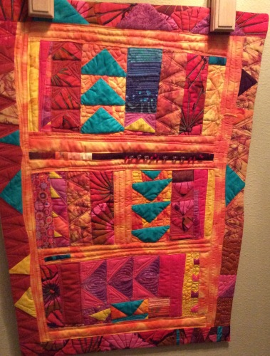 It's Getting Quite Warm in Here (2014). Designed and pieced by Tierney Davis Hogan, quilted by Betty Anne Guadalupe.