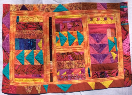 It's Getting Quite Warm in Here (2014). Designed and pieced by Tierney Davis Hogan, quilted by Betty Anne Guadalupe