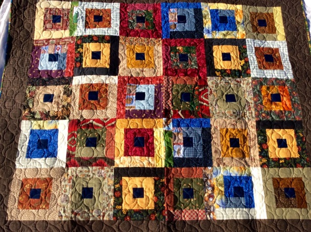 Designed and pieced by Terry and Tierney Hogan, quilted by Betty Anne Guadalupe