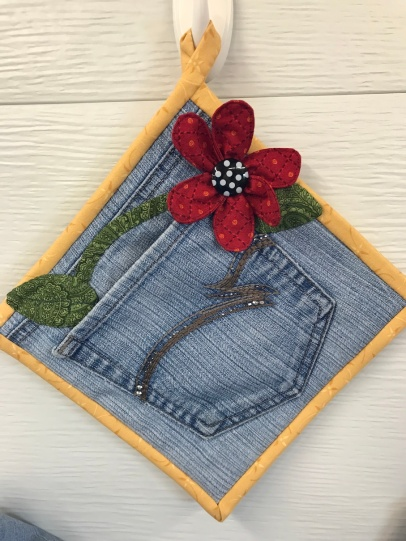 A very cute potholder made with recycled jeans