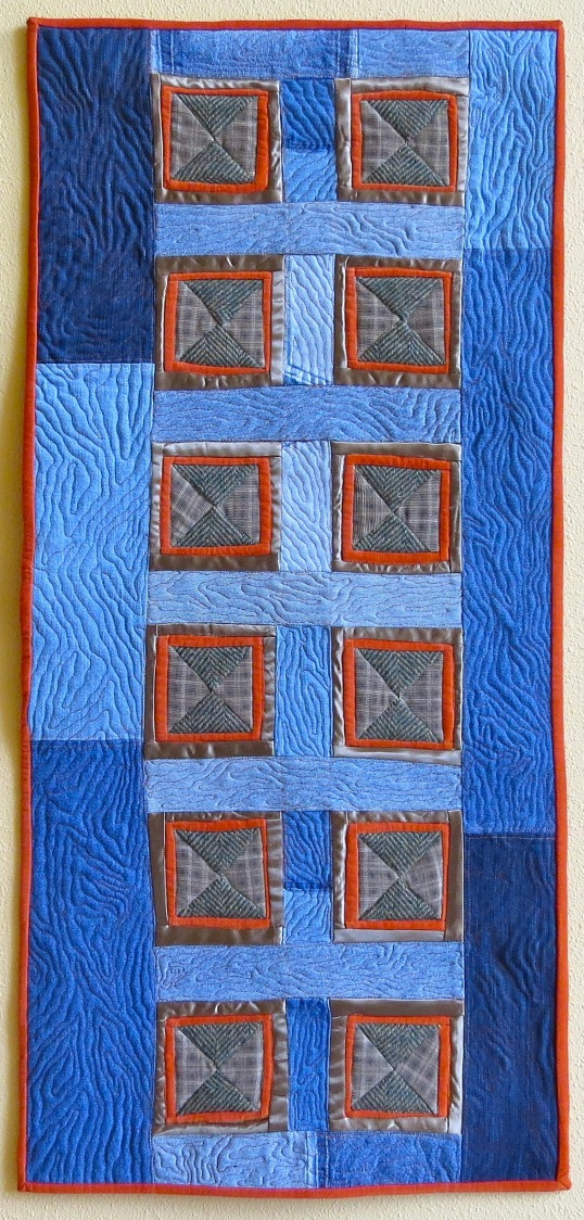 Recycled Door (2017) by Tierney Davis Hogan, quilted by Betty Anne Guadalupe, photographed by Marion Shimoda